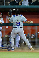 South Bend Cubs catcher Miguel Amaya (9) tries to catch a pop fly in front of the Lansing Lugnuts dugout at Cooley Law School Stadium on June 15, 2018 in Lansing, Michigan. The Lugnuts defeated the Cubs 6-4.  (Brian Westerholt/Four Seam Images)