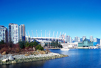 Vancouver Skyline, BC, British Columbia, Canada - BC Place Stadium (New Retractable Roof completed in 2011), Edgewater Casino, and Residential High Rise Condominium Buildings at False Creek - Habitat Island (Artificial Man-made Island) in foreground.