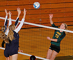 SPEARFISH, SD - NOVEMBER 1, 2013:  Shelby Mayer #13 of Black Hills State hits toward Colorado Christian blockers Summer Greager #21 and Ali Weber #5 during their game at the Donald E. Young Center in Spearfish, S.D. (Photo by Dick Carlson/Inertia)
