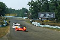 WATKINS GLEN, NY - JUNE 30: The MOMO/Gebhardt Racing Momo C901 Audi of Gianpiero Moretti and Derek Bell is driven ahead of a pair of Jaguar XJR-16 entries during the Camel Continental VIII IMSA GTP/Lights race at the Watkins Glen International track near Watkins Glen, New York, on June 30, 1991.