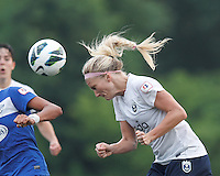 Seattle Reign FC midfielder Kaylyn Kyle (6) heads the ball.  In a National Women's Soccer League (NWSL) match, Seattle Reign FC (white) defeated Boston Breakers (blue), 2-1, at Dilboy Stadium on June 26, 2013.