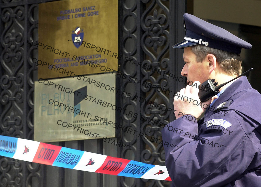 Police officer infront of the entrance to the Football association of Serbia &amp; Montenegro where generaly secretary  of FSSCG Branko Bulatovic was shot today by unindetified person, officials said. Belgrade downtown 26.03.2004. photo: Pedja Milosavljevic<br />