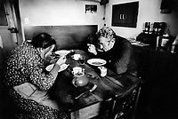 Switzerland. Canton Graubunden. Soglio. Bregaglia valley.  Swiss alpine farmers. Alps mountains peasants. Old couple eats soup for lunch. Dining room. © 1996 Didier Ruef