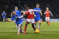 Luke O'Neill of Gillingham gets to grips with Jordy Hiwula of Fleetwood Town during the Sky Bet League 1 match between Gillingham and Fleetwood Town at the MEMS Priestfield Stadium, Gillingham, England on 27 January 2018. Photo by David Horn.