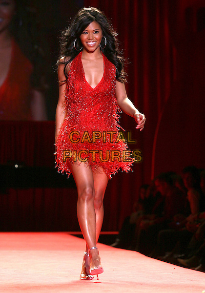 AMERIE.The Heart Truth Red Dress Collection Fashion Show .The Olympus Fashion Week,.New York, New York, USA,.3rd February 2006..full length runway catwalk celebrity modelling .Ref: IW .www.capitalpictures.com.sales@capitalpictures.com.©Capital Pictures