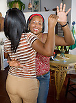 Villa Carolisol's maids dance bachata in the kitchen.