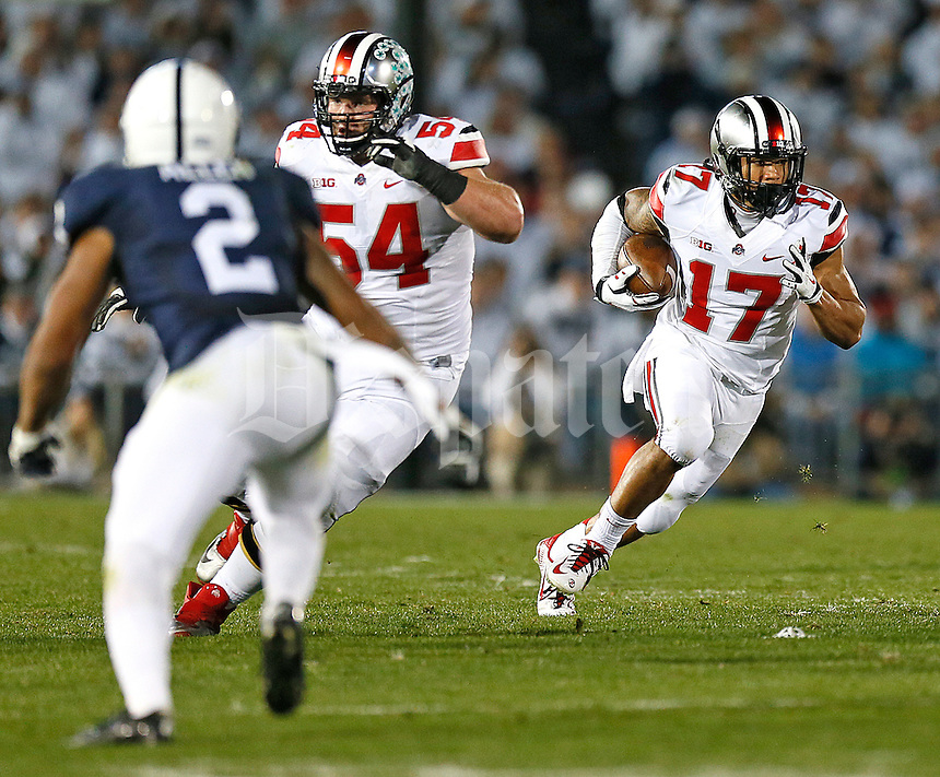 Ohio State Buckeyes running back Jalin Marshall (17) gains short yardage in the third quarter against Penn State at Beaver Stadium on October 25, 2014.  (Chris Russell/Dispatch Photo)