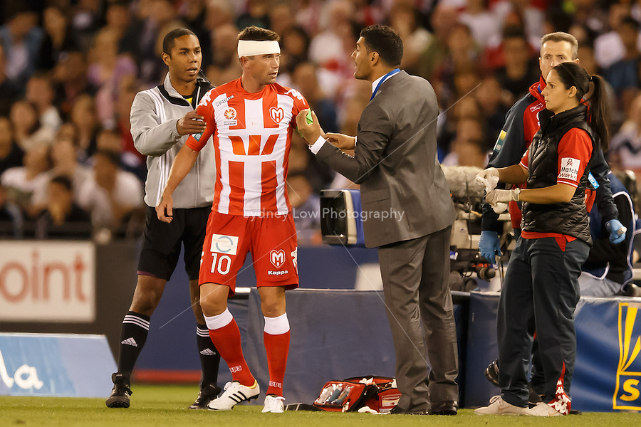 Harry Kewell, captain of the Heart, receives instructions from coach John Aloisi after getting medical attention in the round one match between Melbourne Victory and Melbourne Heart in the Australian Hyundai A-League 2013-24 season at Etihad Stadium, Melbourne, Australia.<br /> This image is not for sale. Please visit zumapress.com for image licensing.