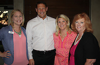 NWA Democrat-Gazette/CARIN SCHOPPMEYER Lauren Marquette, Komen Ozark executive director (from left), Charles and Sue Redfield and Betsy Reithemeyer gather at the Swing for the Cure pre-party Sept. 22 at Shadow Valley Country Club.