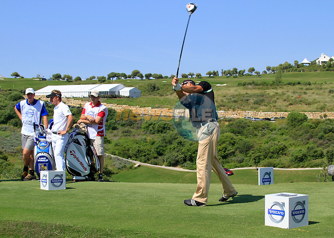 Martin Kaymer (GER) tees off on the 14th tee as Luke Donald (ENG) looks on during the morning Semi-Final session on the Final Day of the Volvo World Match Play Championship in Finca Cortesin, Casares, Spain, 22nd May 2011. (Photo Eoin Clarke/Golffile 2011)