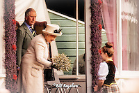 Her Majesty The Queen accepts flowers whilst prince Charles looks on Braemar Gathering 2014