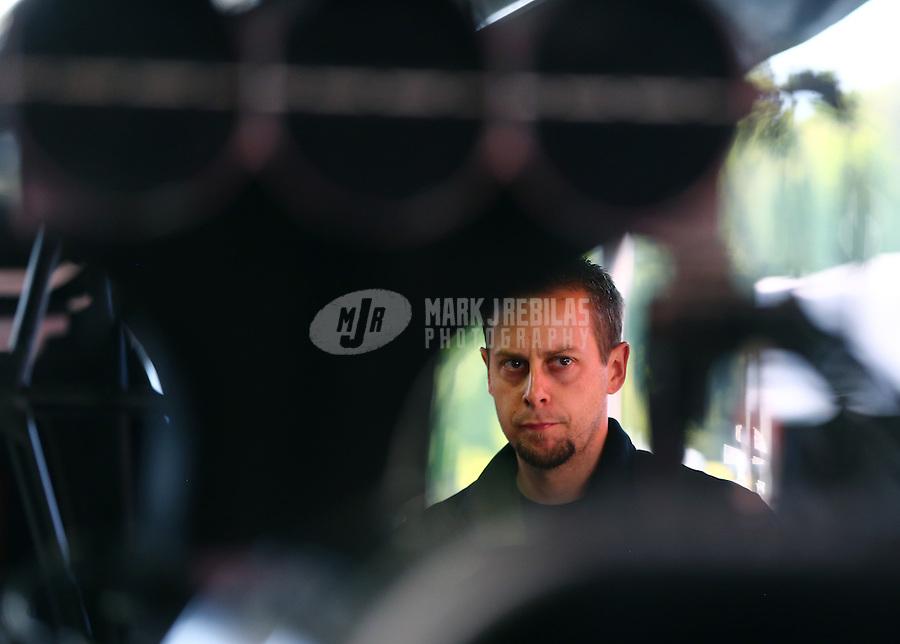 Jun. 1, 2014; Englishtown, NJ, USA; Crew member for NHRA top fuel driver Steve Torrence during the Summernationals at Raceway Park. Mandatory Credit: Mark J. Rebilas-