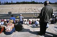02 NOV 2003 - ATHENS, GREECE - Spectators watch the finish of the 21st Athens Classic Marathon in the Kallimarmaro Stadium. (PHOTO (C) NIGEL FARROW)