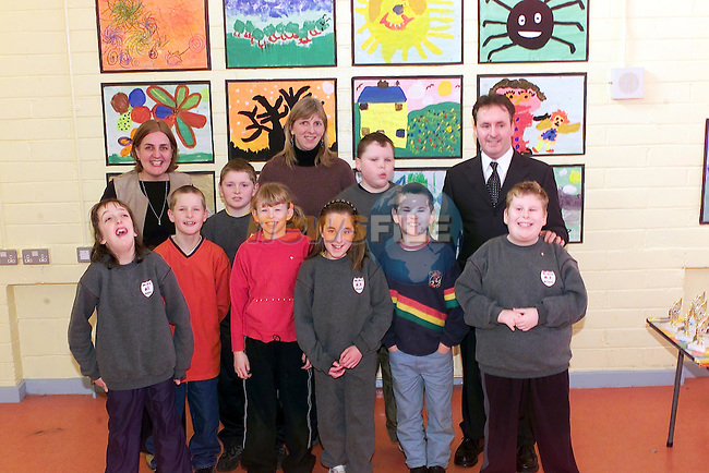 Students from St Itas who took part int he art competition in hte school with Ken Healy right, Kirstie McGee centre Judge and school Principle  ?????..Picture Fran Caffrey Newsfile.