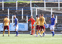 Robby McCrorie arranging his wall in the SPFL Betfred League Cup group match between Queen of the South and Motherwell at Palmerston Park, Dumfries on 13.7.19.