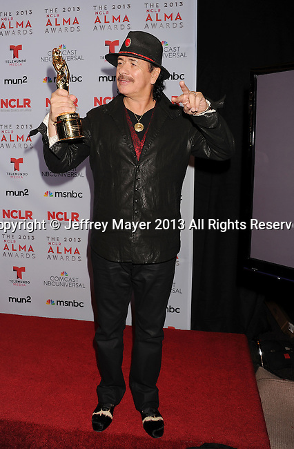 PASADENA, CA- SEPTEMBER 27: Musician Carlos Santana poses in the press room at the 2013 NCLA ALMA Awards at Pasadena Civic Auditorium on September 27, 2013 in Pasadena, California.