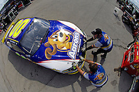 David Reutimann (#00) backs out of his garage.