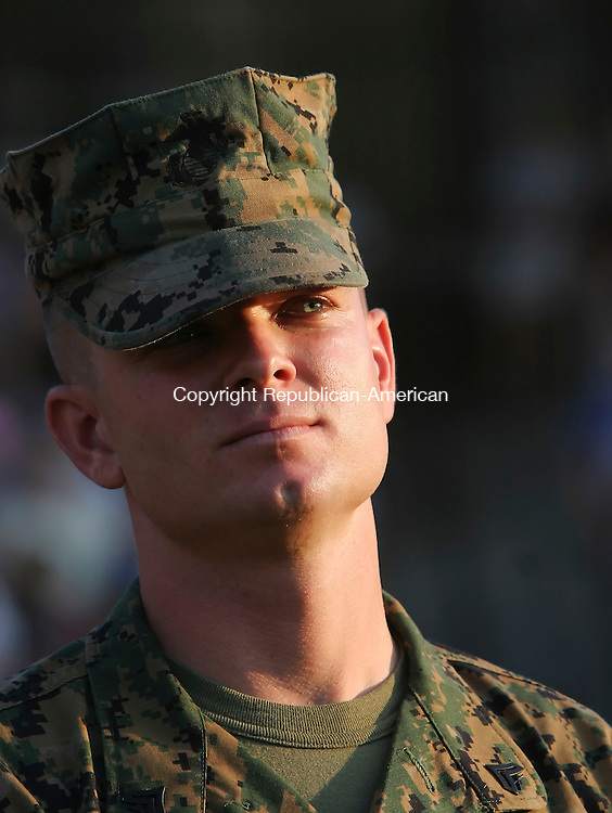NEW BRITAIN,  CT 10 August 2005 -081005BZ2- Former New Britain Rock Cats shortstop and current Marine Cpl. Tony Stevens looks to the outfield while being honored for his military service before the game Wednesday.<br /> Jamison C. Bazinet Photo