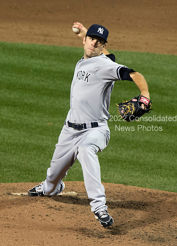 New York Yankees pitcher David Phelps (41) in action against the Baltimore Orioles at Oriole Park at Camden Yards in Baltimore, MD on Tuesday, April 10, 2012.  The Yankees won the game in 12 innings 5 - 4..Credit: Ron Sachs / CNP.(RESTRICTION: NO New York or New Jersey Newspapers or newspapers within a 75 mile radius of New York City)