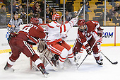 Peter Starrett (Harvard - 14), Joe Pereira (BU - 6), Danny Biega (Harvard - 9) - The Harvard University Crimson defeated the Boston University Terriers 5-4 in the 2011 Beanpot consolation game on Monday, February 14, 2011, at TD Garden in Boston, Massachusetts.