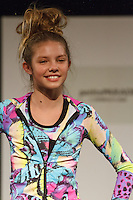 Model walks runway in an outfit by Mod Girl, during the petitePARADE Children's Club fashion show at the Jacob Javits Center in New York City, on January 9, 2016.