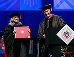 Nancy Hill, professor, receives a Via Sapientiae Award Sunday, June 11, 2017, during the DePaul University Driehaus College of Business commencement ceremony at the Allstate Arena in Rosemont, IL. (DePaul University/Jamie Moncrief)
