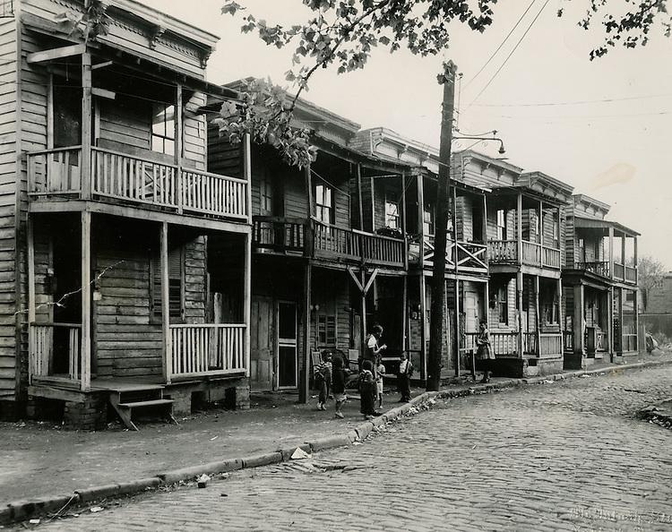 "1951 September..Redevelopment..Project#1 (UR1-1)..Slum Conditions.828 826 822 820 818 Fourth Street.""Young Park""..McIntosh Studio.NEG# copy PLW69-22-9.NRHA# 87.."