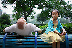 XIAN, CHINA - JUNE 3: An unidentified senior man exercises while a girl looks on in a park on June 3, 2007 in central Xian, China. Many retired people come to the park to do excursive, usually early in the morning. The city has about 3,3 million inhabitants and is the capital of Shaanxi province in China. It was the eastern terminus for the Silk Road and the location for the Terracotta Army during the Qin Dynasty. Its history dates back more than 3,100 years. (Photo by Per-Anders Pettersson)...