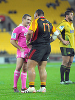 Referee Lourens van der Merwe pulls out a yellow card for Ben Tameifuna during the Super Rugby match between the Hurricanes and Chiefs at Westpac Stadium, Wellington, New Zealand on Friday, 17 May 2013. Photo: Dave Lintott / lintottphoto.co.nz