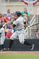 Taylor Gushue (17) of the West Virginia Power follows through on his swing against the Kannapolis Intimidators at Intimidators Stadium on July 3, 2015 in Kannapolis, North Carolina.  The Intimidators defeated the Power 3-0 in a game called in the bottom of the 7th inning due to rain.  (Brian Westerholt/Four Seam Images)