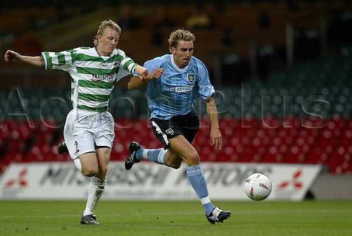 August 28, 2003: Manchester City's DARREN HUCKERBY is challenged by Martin Naylor. TNS  0 v MANCHESTER CITY 2, UEFA Cup Preliminary round 2nd Leg, Millennium Stadium, Cardiff. Photo: Glyn Kirk/action plus...soccer football 030825 player man