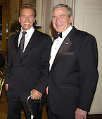 California Gov. Arnold Schwarzenegger (L) is escorted by U.S. President George W. Bush as they arrive in the East Room of the White House for the entertainment portion of a State Dinner in honor of the nation's governors, February 25, 2007 in Washington. The National Governor's Association is holding it's annual Winter meetings in Washington.    POOL PHOTO by Mike Theiler/EPA