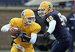 SIOUX FALLS, SD - MAY 4:  Quarterback Trey Heid #2 from Augustana slips from the defenses' Joel Slinden #50 during the Vikings Spring Game Saturday morning at Kirkeby-Over Stadium on the Augustana College Campus. (Photo by Dave Eggen/Inertia)