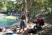 Carolina's daughter Renatta taking a photo. Dzibilchaltun cenote and archeological site with friends. Yucatan, Mexico