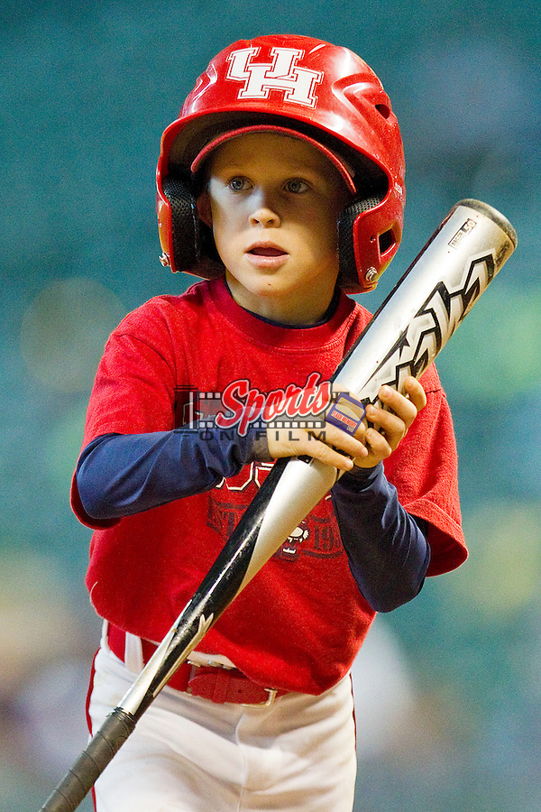 The Houston Cougars bat boy in action during the game against the Kentucky Wildcats at Minute Maid Park on March 5, 2011 in Houston, Texas.  Photo by Brian Westerholt / Four Seam Images