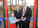 Chairperson of Louth County Council Cllr Oliver Tully, Aaliyah Flood and Chairperson of Dunleer Development Board Tony Mallon cut the ribbon to officially open the new playground in Dunleer. Photo: Colin Bell/pressphotos.ie