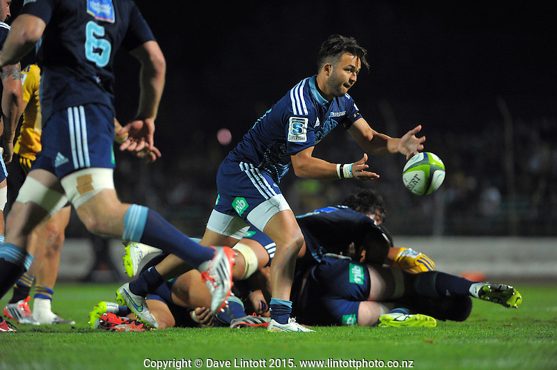 Jamison Gibson-Park passes from a ruck during the Super Rugby match between the Hurricanes and Blues at FMG Stadium, Palmerston North, New Zealand on Friday, 13 March 2015. Photo: Dave Lintott / lintottphoto.co.nz