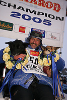 """Robert Sorlie and his two lead dogs """"Sox"""" and """"Blue""""  at the finish line in Nome.  End of the  2005 Iditarod Trail Sled Dog Race."""