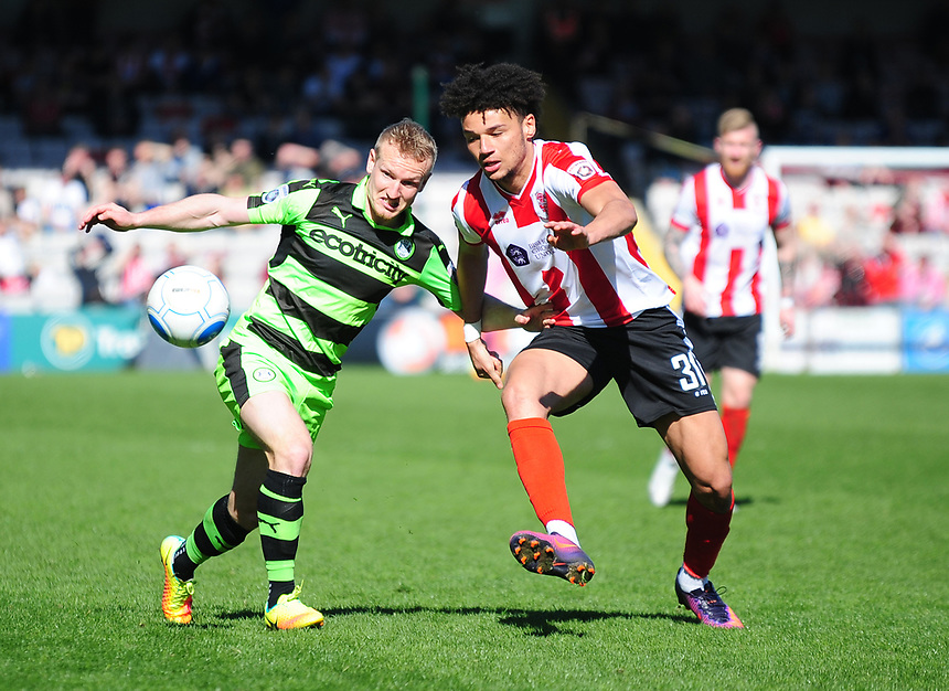 Lincoln City's Lee Angol vies for possession with Forest Green Rovers' Marcus Kelly<br /> <br /> Photographer Andrew Vaughan/CameraSport<br /> <br /> Vanarama National League - Lincoln City v Forest Green Rovers - Saturday 25th March 2017 - Sincil Bank - Lincoln<br /> <br /> World Copyright &copy; 2017 CameraSport. All rights reserved. 43 Linden Ave. Countesthorpe. Leicester. England. LE8 5PG - Tel: +44 (0) 116 277 4147 - admin@camerasport.com - www.camerasport.com