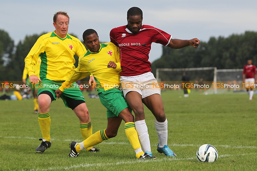 East London (yellow/green) vs FC Haggerston - Hackney & Leyton Sunday League Football at South Marsh, Hackney Marshes, London - 15/09/13 - MANDATORY CREDIT: Gavin Ellis/TGSPHOTO - Self billing applies where appropriate - 0845 094 6026 - contact@tgsphoto.co.uk - NO UNPAID USE