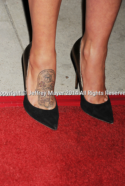 LOS ANGELES, CA- SEPTEMBER 16: Actress Genesis Rodriguez (shoe, tattoo detail) at the Los Angeles premiere of 'Tusk' at the Vista Theatre on September 16, 2014 in Los Angeles, California.