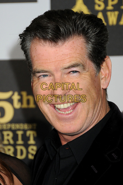 PIERCE BROSNAN.25th Annual Film Independent Spirit Awards - Arrivals held at the Nokia Event Deck at L.A. Live, Los Angeles, California, USA..March 5th, 2010.headshot portrait black smiling .CAP/ADM/BP.©Byron Purvis/AdMedia/Capital Pictures.