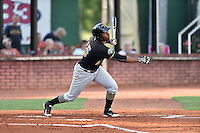 Bristol Pirates third baseman Julio De La Cruz (15) swings at a pitch during a game against the Elizabethton Twins at Joe O'Brien Field on July 30, 2016 in Elizabethton, Tennessee. The Twins defeated the Pirates 6-3. (Tony Farlow/Four Seam Images)