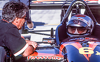 Mario Andretti, L, talks with Michael Andretti, Marlboro Grand Prix of Miami, CART race, March 26, 2000.  (Photo by Brian Cleary/bcpix.com)