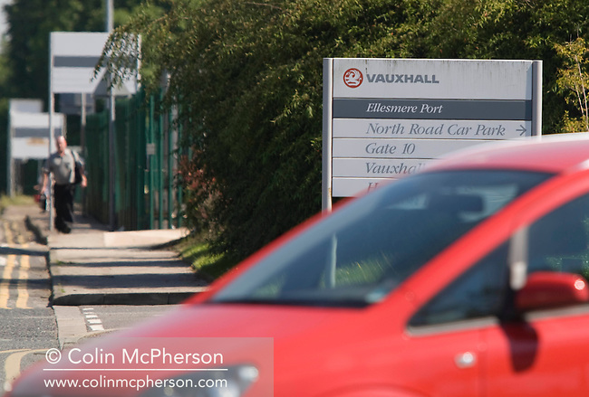 A worker leaving GM Vauxhall's Ellesmere Port factory in Cheshire at the end of a shift. The plant's future is to be decided in the coming weeks after the parent company, General Motors, went into administration and its European arm was sold off. Today was the factory's first day of production following the Whit holiday.