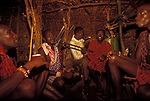 Maasai Moran drink traditional honey beer as part of their initiation ceremony into manhood.  They will all live comunally  inside the moran village for several months.