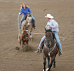 Josh Motley and Kathryn Bradley compete in team roping 40-50 bracket.