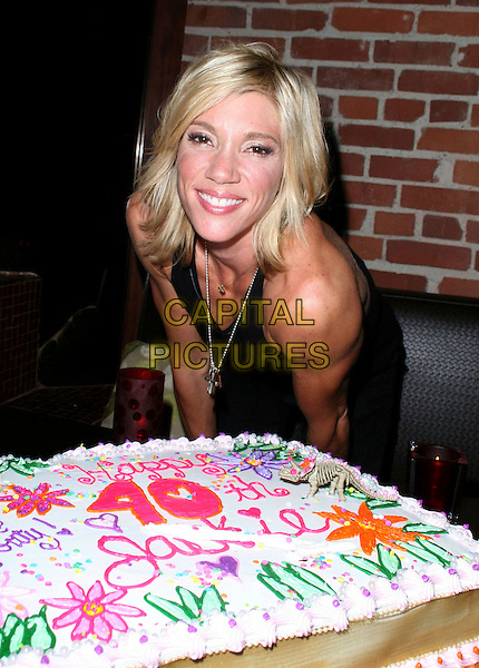 JACKIE WARNER.Jackie Warner celebrates her 40th Birthday at Club Eleven, West Hollywood, California, USA..August 16th, 2008.half length black tank top birthday cake .CAP/ADM/FS.©Faye Sadou/AdMedia/Capital Pictures.