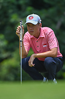 Joshua HO (SIN) lines up his putt on 4 during Rd 2 of the Asia-Pacific Amateur Championship, Sentosa Golf Club, Singapore. 10/5/2018.<br /> Picture: Golffile | Ken Murray<br /> <br /> <br /> All photo usage must carry mandatory copyright credit (© Golffile | Ken Murray)