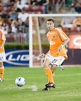 Houston Dynamo midfielder Geoff Cameron (20) strikes the ball. Houston Dynamo defeated Pachuca FC 2-0 during the semifinals of the Superliga 2008 tournament at Robertson Stadium in Houston, TX on July 29, 2008.